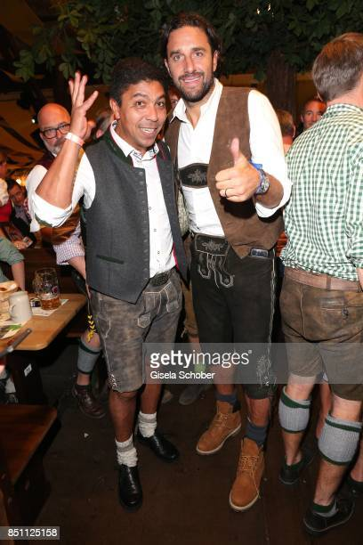 Giovane Elber and Luca Toni former FC Bayern soccer player during the Oktoberfest at Winzerer Faehndl tent at Theresienwiese on September 21 2017 in...