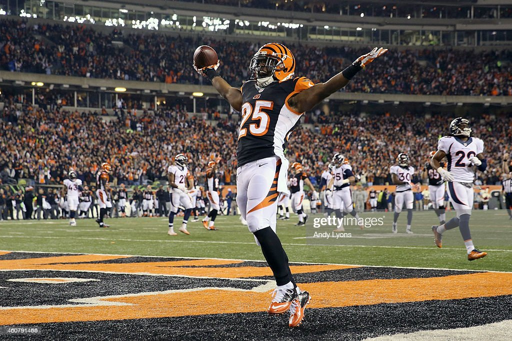 Giovani Bernard #25 of the Cincinnati Bengals celebrates after scoring a touchdown during the third quarter of the game against the Denver Broncos at Paul Brown Stadium on December 22, 2014 in Cincinnati, Ohio.