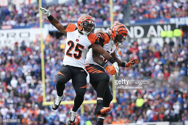 Giovani Bernard of the Cincinnati Bengals celebrates his touchdown against the Buffalo Bills with Jeremy Hill of the Cincinnati Bengals during the...