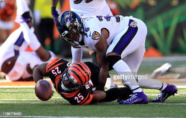 Giovani Bernard of the Cincinnati Bengals fumbles the ball after being tackled by Chuck Clark of the Baltimore Ravens at Paul Brown Stadium on...