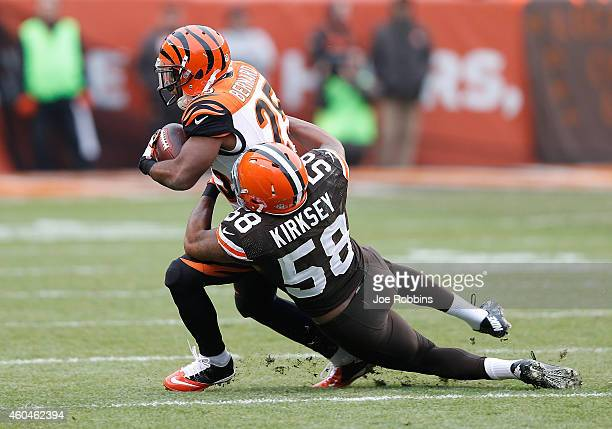 Giovani Bernard of the Cincinnati Bengals gets tackled by Chris Kirksey of the Cleveland Browns during the first quarter at FirstEnergy Stadium on...