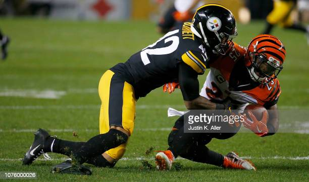 Giovani Bernard of the Cincinnati Bengals is wrapped up for a tackle by Morgan Burnett of the Pittsburgh Steelers in the third quarter during the...