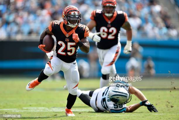 Giovani Bernard of the Cincinnati Bengals runs the ball against David Mayo of the Carolina Panthers in the second quarter during their game at Bank...