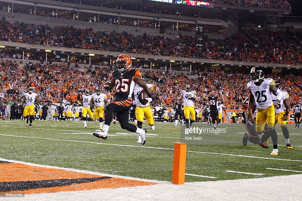 Giovani Bernard #25 of the Cincinnati Bengals runs the ball into the end zone for a touchdown during the third quarter against the Pittsburgh Steelers on September 16, 2013 at Paul Brown Stadium on September 16, 2013 in Cincinnati, Ohio. Cincinnati defeated Pittsburgh 20-10.