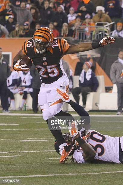 Giovani Bernard of the Cincinnati Bengals runs the football upfield against David Bruton Jr #30 of the Denver Broncos during their game at Paul Brown...