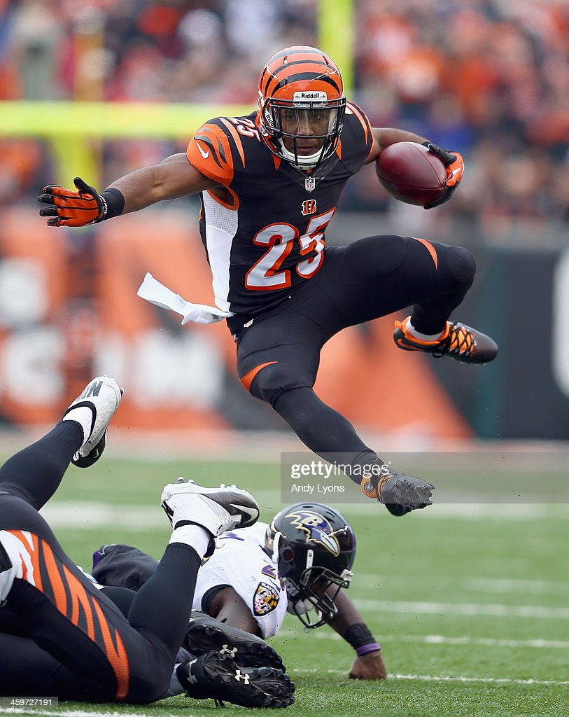 Giovani Bernard #25 of the Cincinnati Bengals runs with the ball during the NFL game against the Baltimore Ravens at Paul Brown Stadium on December 29, 2013 in Cincinnati, Ohio.