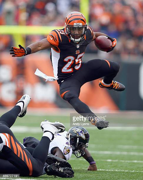 Giovani Bernard of the Cincinnati Bengals runs with the ball during the NFL game against the Baltimore Ravens at Paul Brown Stadium on December 29,...
