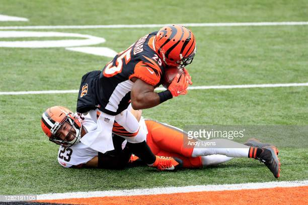 Giovani Bernard of the Cincinnati Bengals scores a touchdown against Andrew Sendejo of the Cleveland Browns during the second half at Paul Brown...