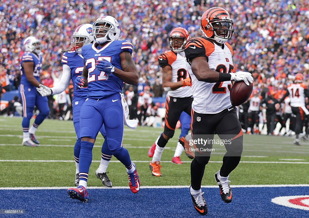 Giovani Bernard #25 of the Cincinnati Bengals scores a touchdown past Duke Williams #27 of the Buffalo Bills during the first half at Ralph Wilson Stadium on October 18, 2015 in Orchard Park, New York.