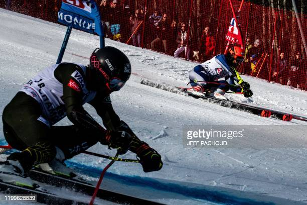 TOPSHOT Giovani Borsotti competes against US skier Tommy Ford during the Audi FIS Alpine Ski World Cup Men's Parallel Giant Slalom in Chamonix France...