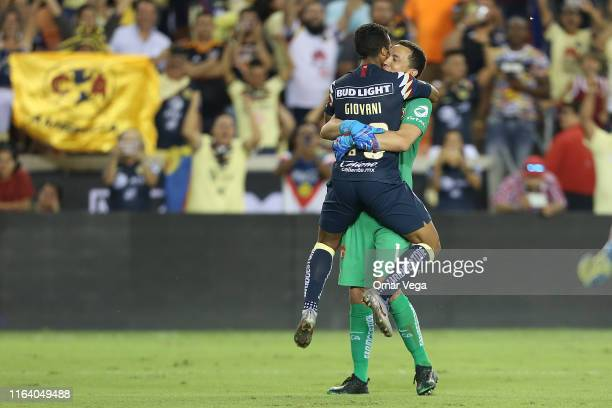 Giovani dos Santos and Agustin Marchesin celebrate after winning the quarterfinals match between Club America and Houston Dynamo as part of the...