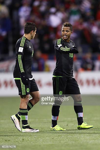 Giovani dos Santos and Javier Hernandez of Mexico talk during the match between USA and Mexico as part of FIFA 2018 World Cup Qualifiers at MAPFRE...