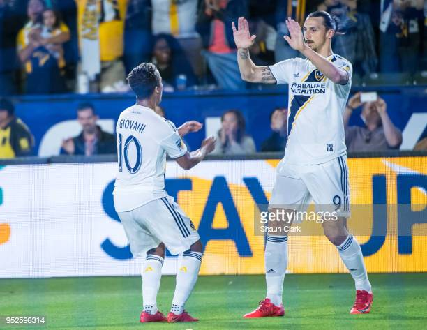 Giovani dos Santos and Zlatan Ibrahimovic of Los Angeles Galaxy celebrate a goal by Giovani dos Santos during the Los Angeles Galaxy's MLS match...
