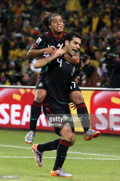 Giovani Dos Santos celebrates with Rafael Marquez of Mexico after he scored the second goal to equalise during the 2010 FIFA World Cup South Africa...