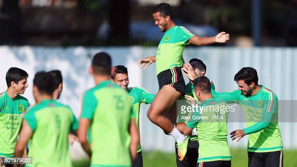 Giovani dos Santos is lifted in the air by his team mates during a Mexico training session at Adler training ground ahead of their FIFA...
