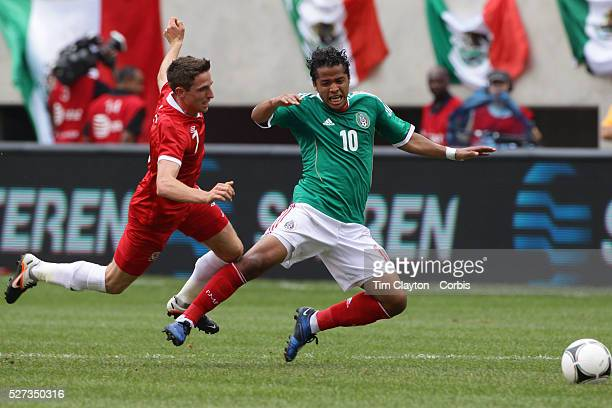 Giovani Dos Santos Mexico is fouled by Joe Allen Wales during the Mexico V Wales international football friendly match at MetLife Stadium East...