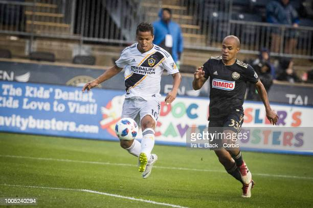 Giovani dos Santos of LA Galaxy kicks the ball to keep posession during the Major League Soccer match between LA Galaxy and Philadelphia Union at...