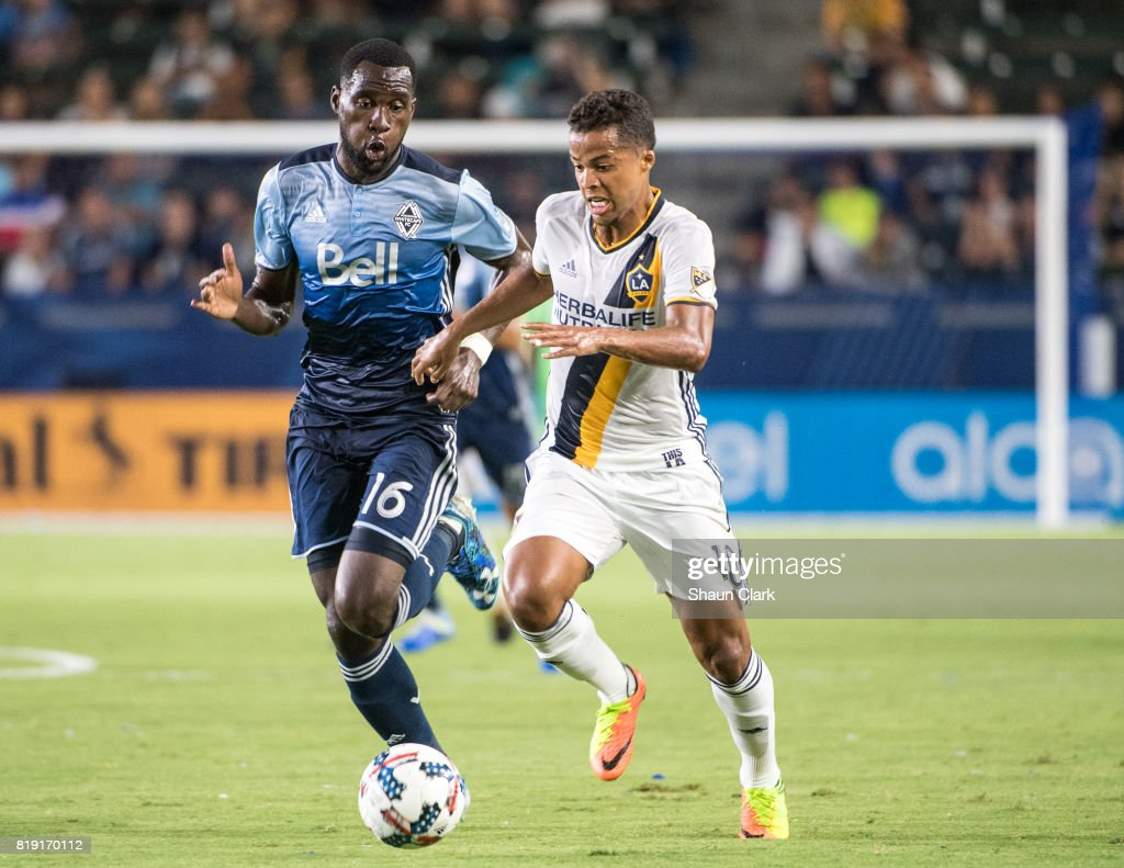 Giovani dos Santos #10 of Los Angeles Galaxy battles Tony Tchani #16 of Vancouver Whitecaps during the Los Angeles Galaxy's MLS match against Vancouver Whitecaps at the StubHub Center on July 19, 2017 in Carson, California. Vancouver won the match 1-0