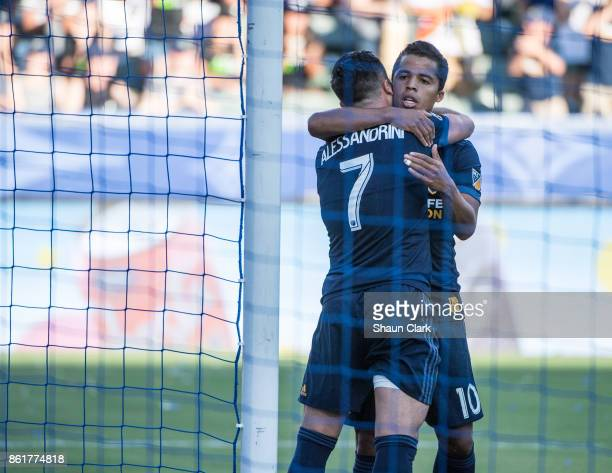 Giovani dos Santos of Los Angeles Galaxy congratulates Romain Alessandrini of Los Angeles Galaxy on his goal during the Los Angeles Galaxy's MLS...