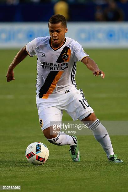 Giovani dos Santos of Los Angeles Galaxy dribbles the ball against the Portland Timbers during the first half of their MLS match at StubHub Center on...