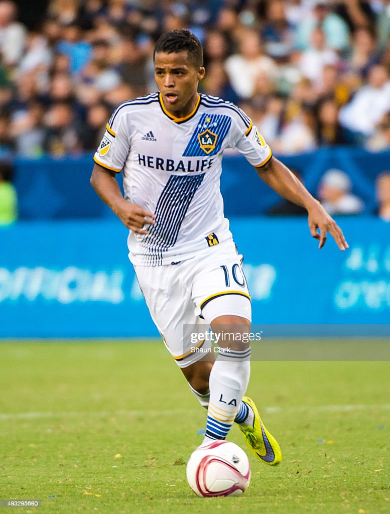 Giovani Dos Santos #10 of Los Angeles Galaxy dribbles upfield during Los Angeles Galaxy's MLS match against Portland Timbers at the StubHub Center on October 18, 2015 in Carson, California. The Portland Timbers won the match 5-2