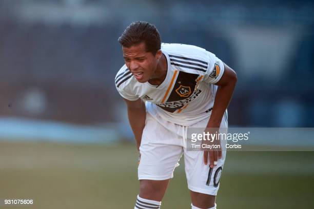 Giovani dos Santos of Los Angeles Galaxy feels his hamstring during the New York City FC Vs LA Galaxy regular season MLS game at Yankee Stadium on...