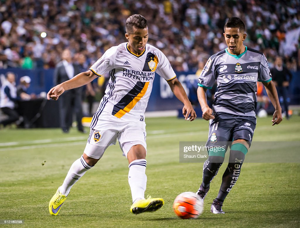 Giovani dos Santos #10 of Los Angeles Galaxy gets past Nestor Calderon #11 of Santos Laguna during the CONCACAF Champions League match between Santos Laguna and Los Angeles Galaxy at the StubHub Center on February 24, 2016 in Carson, California. The final score was 0-0