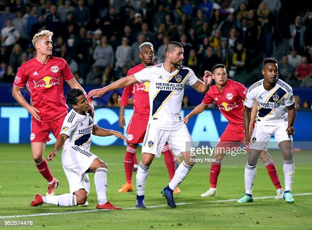 Giovani dos Santos of Los Angeles Galaxy scores a goal in front of Perry Kitchen and Ola Kamara to tie the game 22 during the second half of a 32 New...