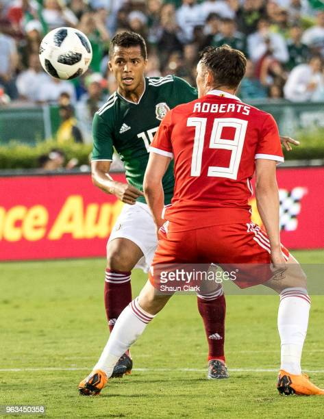 Giovani Dos Santos of Mexico and Connor Roberts of Wales during the international friendly match between Mexico and Wales at the Rose Bowl on May 28...