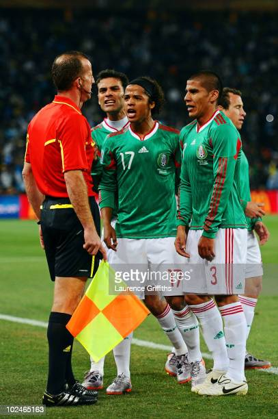 Giovani Dos Santos of Mexico and team mates appeal to referee assistant Stefano Ayroldi over the Carlos Tevez goal during the 2010 FIFA World Cup...