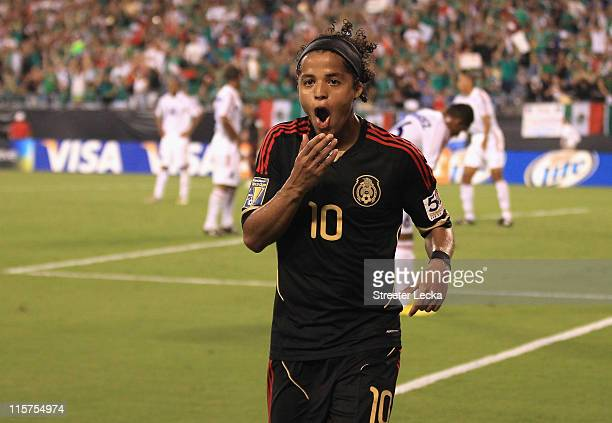 Giovani Dos Santos of Mexico celebrates after scoring a goal against Cuba during their game in the CONCACAF Gold Cup at Bank of America Stadium on...
