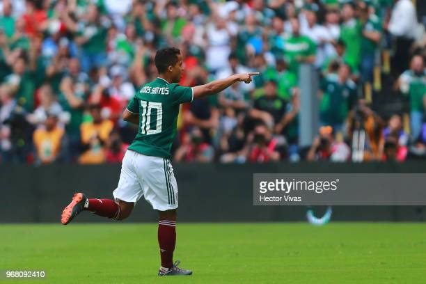 Giovani Dos Santos of Mexico celebrates after scoring the first goal of his team during the International Friendly match between Mexico v Scotland at...