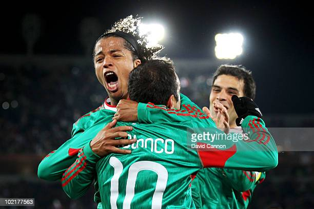 Giovani Dos Santos of Mexico celebrates with Cuauhtemoc Blanco after he scored a penalty for his team's second goal during the 2010 FIFA World Cup...