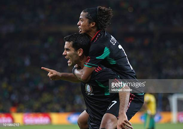 Giovani Dos Santos of Mexico celebrates with Rafael Marquez of Mexico after he scored the second goal to equalise during the 2010 FIFA World Cup...