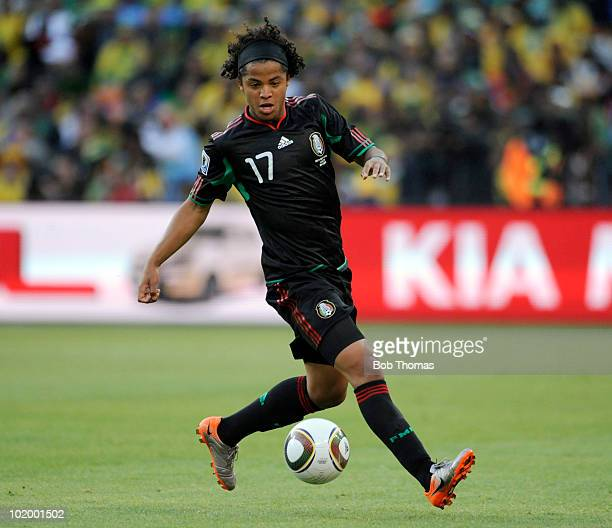 Giovani Dos Santos of Mexico during the 2010 FIFA World Cup South Africa Group A match between South Africa and Mexico at Soccer City Stadium on June...