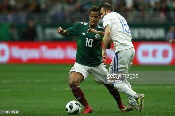 Giovani Dos Santos of Mexico fights for the ball with Elvis Saric of Bosnia and Herzegovina during the friendly match between Mexico and Bosnia and...