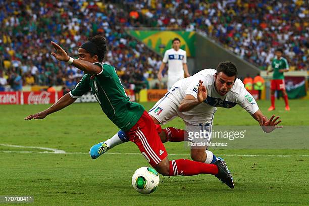 Giovani dos Santos of Mexico is brought down in the penalty box by Andrea Barzagli of Italy during the FIFA Confederations Cup Brazil 2013 Group A...