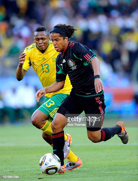 Giovani Dos Santos of Mexico is chased by Kagisho Dikgacoi of South Africa during the 2010 FIFA World Cup South Africa Group A match between South...