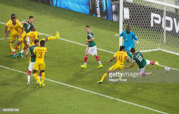 Giovani dos Santos of Mexico puts the ball in the net but the goal was disallowed due to an offsides call as Charles Itandje of Cameroon looks on in...