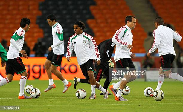 Giovani Dos Santos of Mexico runs through drills with teammates during a Mexico training session ahead of the 2010 FIFA World Cup South Africa at...
