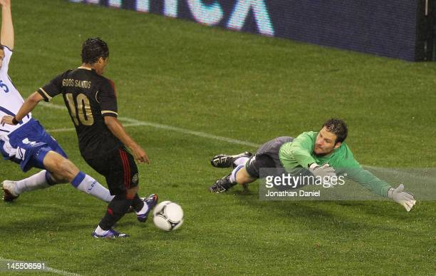 Giovani Dos Santos of Mexico scores a goal past Asmir Begovic of BosniaHerzegovina during an international friendly at Soldier Field on May 31 2012...