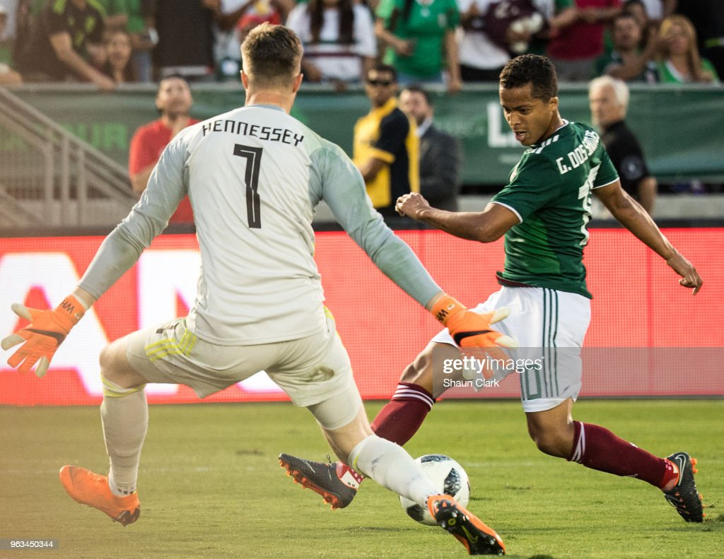 NT & NT CLASSIC KITS by PUMA26 - Page 15 Giovani-dos-santos-of-mexico-tries-to-shoot-past-wayne-hennessey-of-picture-id963450344