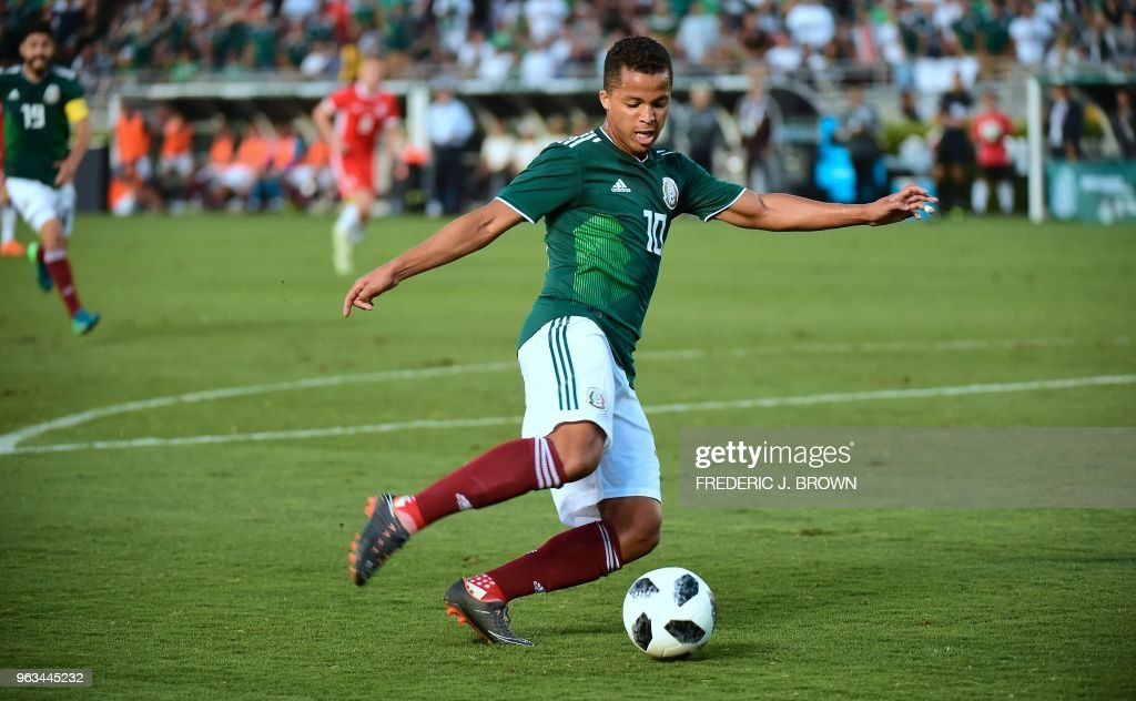 Giovani dos Santos of Mexico turns with the ball against Wales during their international soccer friendly at the Rose Bowl in Pasadena, California on May 28, 2018. - The game ended 0-0.