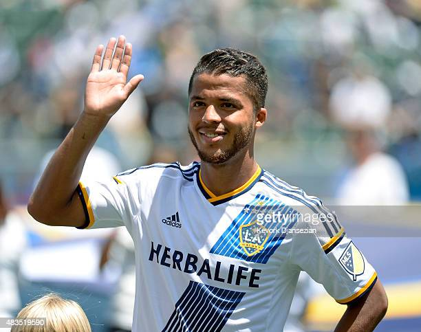 Giovani Dos Santos of the Los Angeles Galaxy acknowledges cheers from fans as he makes his MLS debut before the start of soccer match between Los...