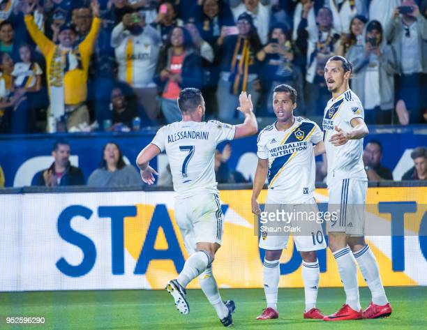 Giovani dos Santos Zlatan Ibrahimovic and Romain Alessandrini of Los Angeles Galaxy celebrate a goal by Giovani dos Santos during the Los Angeles...