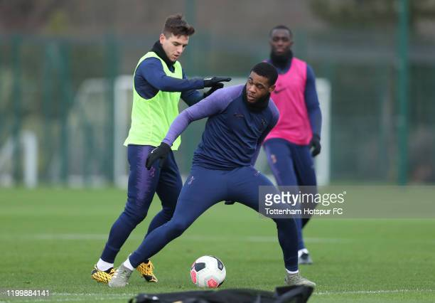 Giovani Lo Celso and Japhet Tanganga of Tottenham Hotspur during the Tottenham Hotspur training session at Tottenham Hotspur Training Centre on...