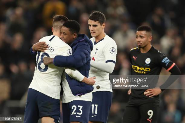 Giovani Lo Celso and Steven Bergwijn and Erik Lamela of Tottenham Hotspur celebrate at full time of the Premier League match between Tottenham...