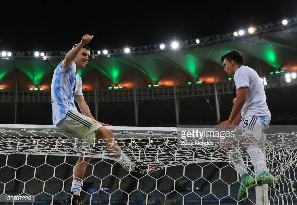 Giovani Lo Celso and teammate Marcos Acuña of Argentina celebrate after winning the final of Copa America Brazil 2021 between Brazil and Argentina at...