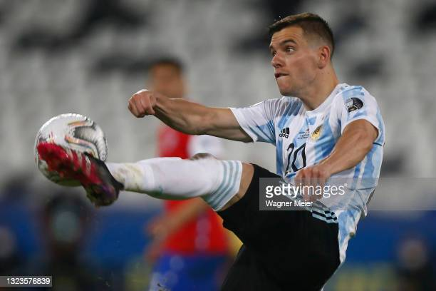 Giovani Lo Celso of Argentina kicks the ball during a Group A match between Argentina and Chile at Estadio Olímpico Nilton Santos as part of Copa...