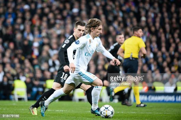 Giovani Lo Celso of Paris Saint Germain and Luka Modric of Real Madrid during the Champions League match between Real Madrid and Paris Saint Germain...